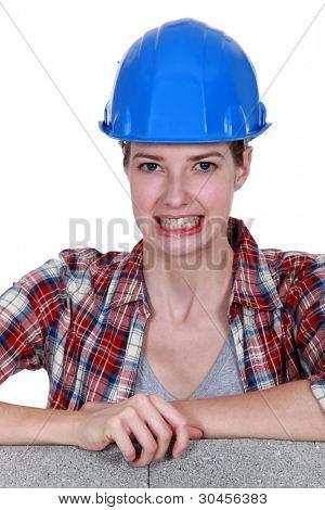Tradeswoman baring her teeth