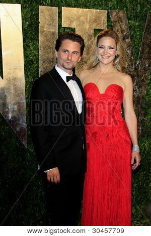 WEST HOLLYWOOD, CA - FEB 26: Kate Hudson; Matthew Bellamy at the Vanity Fair Oscar Party at Sunset Tower on February 26, 2012 in West Hollywood, California.
