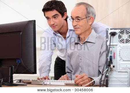 Computer technician helping office worker
