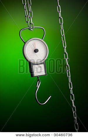 pocket balance scales on green