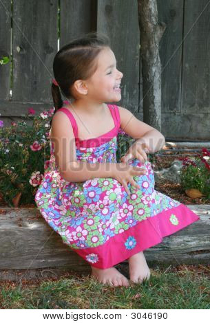 A Young Girl Laughing In The Sunshine