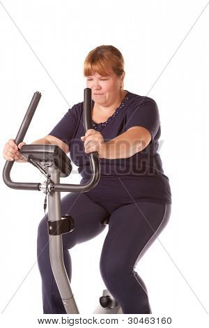 tired fat woman training on the bike