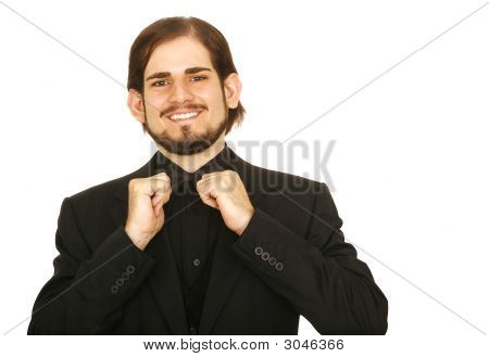 Man In Tuxedo Holding His Bow Tie