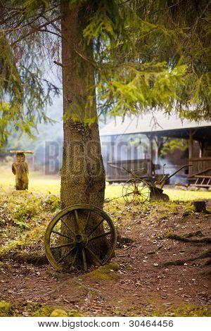 Old wagon wheel on the tree