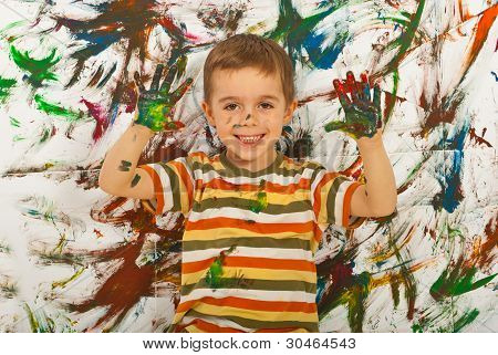 Happy Messy Boy Showing Colorful Palms
