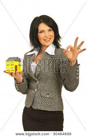 Successful Business Woman With House