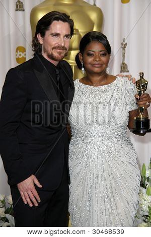 LOS ANGELES - FEB 26:  Christian Bale; Octavia Spencer arrives at the 84th Academy Awards at the Hollywood & Highland Center on February 26, 2012 in Los Angeles, CA.