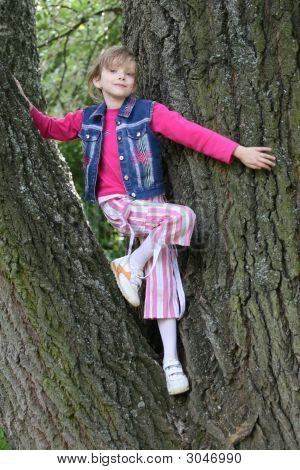 Young Girl Posing Among Trees