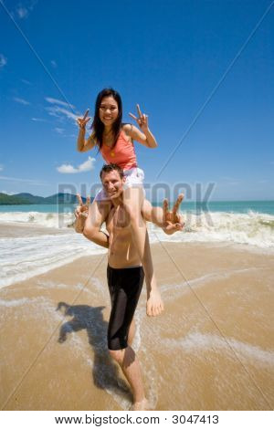 Couple Playful By The Beach
