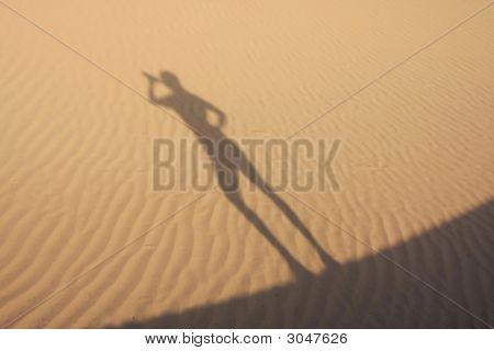 Shadow In Dunes Drinking Man