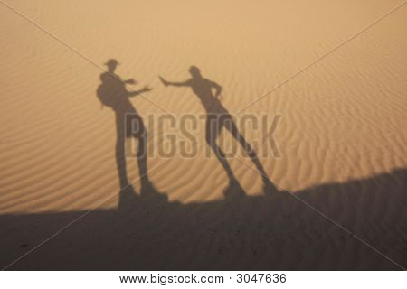 Shadow In Dunes With Thirsty Man
