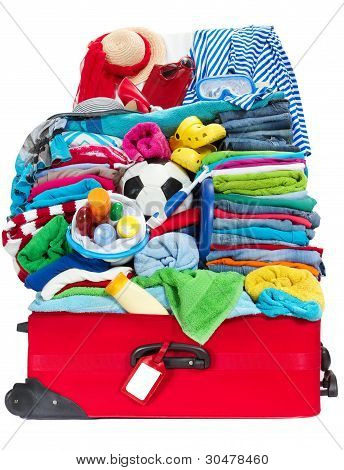 Travel Suitcase Packed For Vacation In Sea Resort. Preparation For Holidays, Overloaded