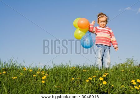Cute Girl With Colorful Balloons And Copyspace