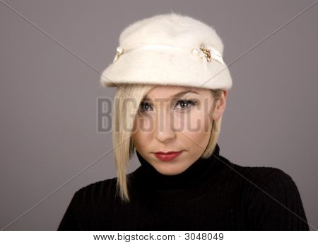 Blonde In Fur Hat With Sad Face