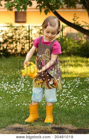 Young Girl Playing With The Watering Can