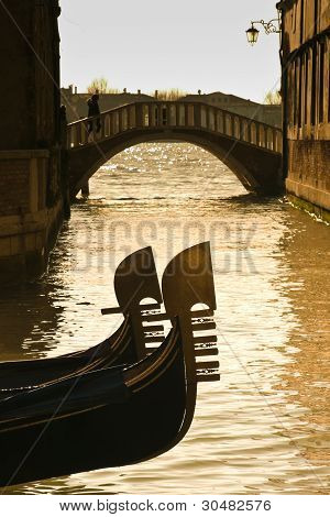 Prows Of Two Gondolas In Venice