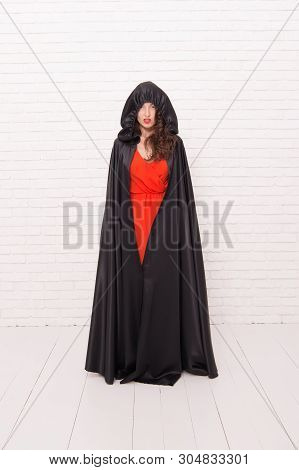 poster of Creating Spooky Holiday Moments. Sexy Girl Wearing Halloween Holiday Costume In Traditional Style. S