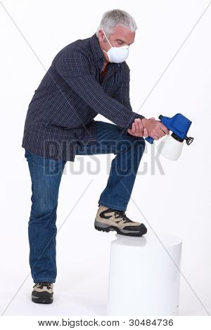 Man using a spray gun