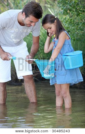 father and his little girl fishing