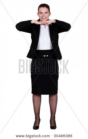 Businesswoman leaning her chin on her hands.