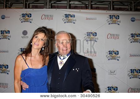 LOS ANGELES - FEB 26:  Michelle Sucillon; Buzz Aldrin arrive at the