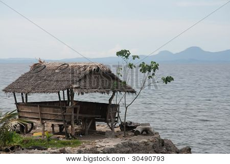 wooden hut over looking the sea