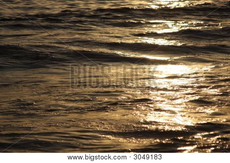 Shot Of  Sunlight Hitting Waves In An Angle