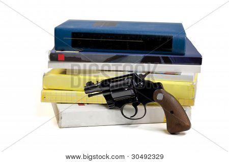 Textbooks And Pistol
