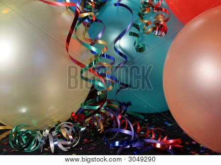 A Group Of  Multi Colored Party Balloons With Ribbons