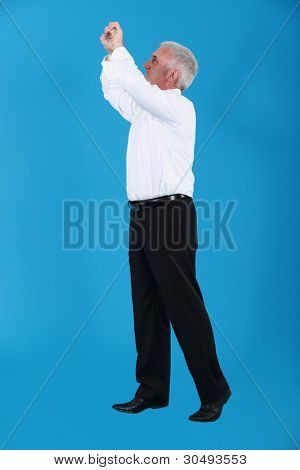 Man gripping an invisible bar