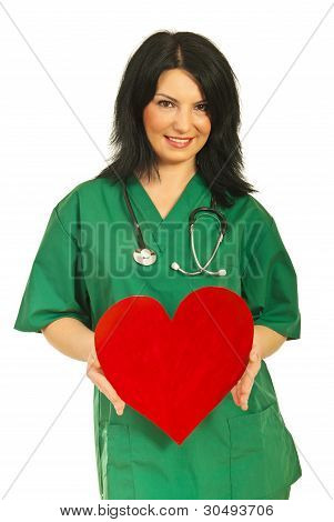 Attractive Doctor Woman Give Heart