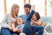 Happy young family at home poster