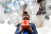 Bearded Man In Suit Holds Birthday Gift. Festive Event Or Birthday Party. People, Joy, Birthday, Cel poster