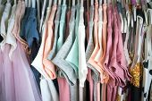 Set Of Clothes For Kids On Hangers. Shopping. poster