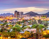Tucson, Arizona, USA downtown city skyline with mountains at twilight. poster