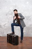 Best Travel Bags For Men. Guy Well Groomed Elegant Bearded Man And Vintage Suitcase. Time Traveller  poster