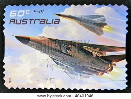 A stamp printed in australia shows The General Dynamics F-111