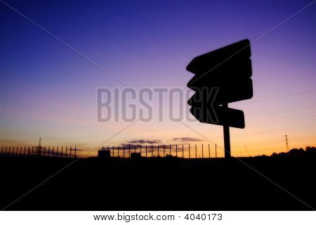 Industrial Landscape With Roadsign
