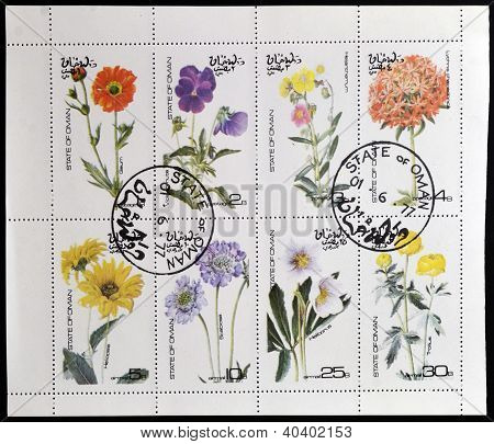 OMAN - CIRCA 1977: A collection stamps printed in Oman showing eight types of flowers circa 1977