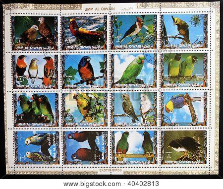 UMM AL QIWAIN - CIRCA 1973: Collection stamps printed in Umm al Qiwain shows Parrots circa 1973