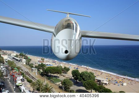 White Sailplane Flying Over Sea Coast Frontal