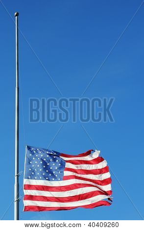 American flag flying at half staff in memory of Newtown massacre victims.
