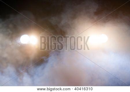 Car Headlights of a car at night