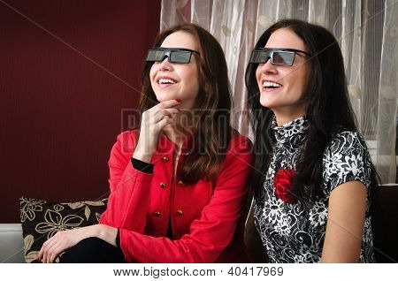 Young Beautiful Women Watching 3D Tv At Home