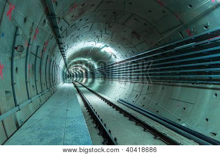 Underground tunnel with blue lights angle shot