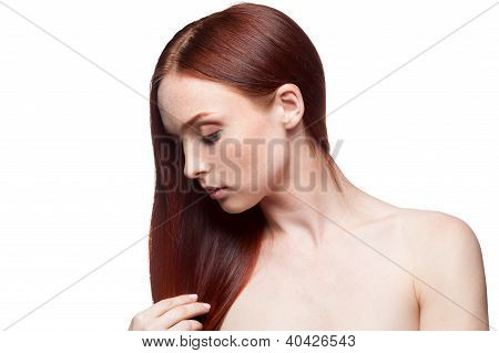 Beautiful Red Haired Girl Touching Hair