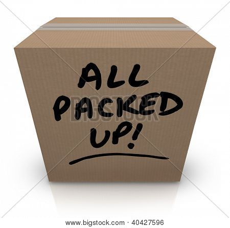 The words All Packed Up written on a cardboard box with black marker to indicate you are prepared to relocate or for moving to another location