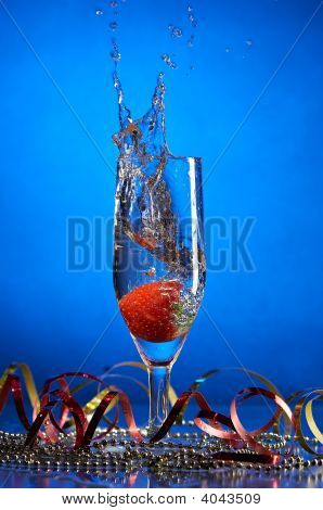 Glass With Champagne And Strawberries