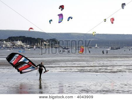 Kite Surfer Walks Mudflats