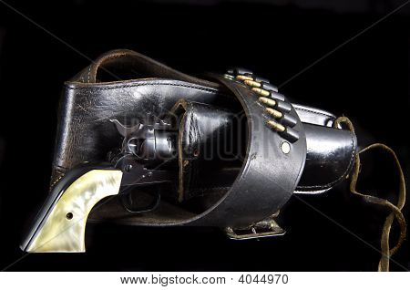 Old Western Six Gun Revolver Isolated On Black